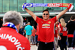 Manchester United fans pose with matchday scarves outside the ground ahead of the Premier League match at Old Trafford Stadium, Manchester. Picture date: September 24th, 2016. Pic Sportimage