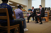 Arlington, VA - September 8, 2009 -- United States President Barack Obama (2-R) and US Education Secretary Arne Duncan (R) host a group discussion with students at Wakefield High School in Arlington, Virginia, USA, 08 September 2009.  President Obama attends the event to encourage students to study hard and take responsibility for their own education on the first day of the school year for many children across America.  .Credit: Michael Reynolds - Pool via CNP