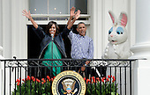 United States President Barack Obama (R) and first lady Michelle Obama (L) waves with the Easter Bunny during the White House Easter Egg Roll on the South Lawn of the White House March 28, 2016 in Washington, DC. <br /> Credit: Olivier Douliery / Pool via CNP