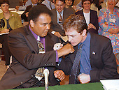 Michael J. Fox, right, and Mohammad Ali, left, clown for the cameras prior to their giving testimony before the United States Senate Appropriations Subcommittee on Labor and HHS on Parkinson's Disease on Capitol Hill in Washington, DC on May 22, 2002.  Both Mr. Fox and The Champ advocated for increased funding to the National Institutes of Health (NIH) for Parkinson's research.<br /> Credit: Ron Sachs / CNP