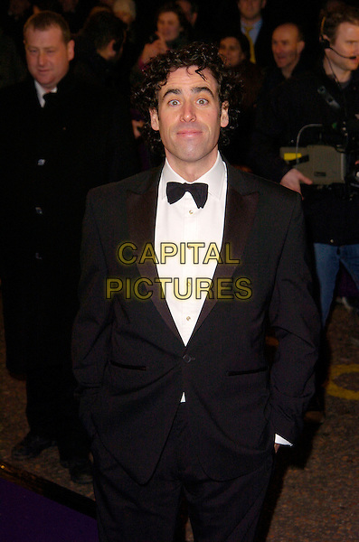 STEPHEN MANGAN.British Comedy Awards 2007, London Studios, South Bank, London, England. .December 5th 2007.half length 3/4 black tuxedo hands in pockets .CAP/CAN.©Can Nguyen/Capital Pictures
