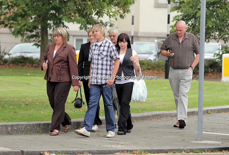 Pictured: The mother of Joshua Davies Hayley (L), his father Steven (R) with relatives and friends arriving at Swansea Crown Court. Friday 02 September 2011<br /> Re: A 16-year-old boy who battered his former girlfriend to death is due to be sentenced on today (Fri 02 September 2011) for her murder.<br /> Rebecca Aylward, 15, from Maesteg, was lured into a wood in Aberkenfig, near Bridgend, in October 2010. <br /> Joshua Davies denied murder, blaming his friend, but was convicted by a 10-2 majority verdict in July.