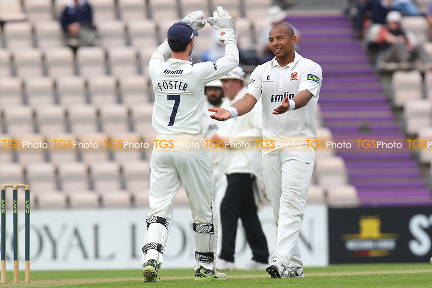 Tymal Mills of Essex (R) celebrates the wicket of Matt Coles with James Foster - Hampshire CCC vs Essex CCC - LV County Championship Division Two Cricket at the Ageas Bowl, West End, Southampton - 15/06/14 - MANDATORY CREDIT: Gavin Ellis/TGSPHOTO - Self billing applies where appropriate - 0845 094 6026 - contact@tgsphoto.co.uk - NO UNPAID USE