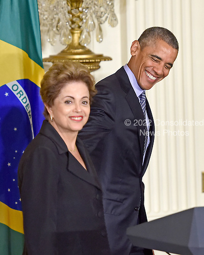 United States President Barack Obama, right, and President Dilma Rousseff of Brazil, left, depart the East Room of the White House in Washington, D.C. following their joint press conference on Tuesday, June 30, 2015.<br /> Credit: Ron Sachs / CNP