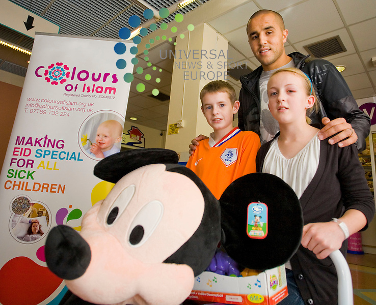 Rangers' Star Madjid Bougherra Visits Royal Hospital for Sick children Yorkhill Glasgow,to hand out toys to the kids  to celebrate the.Muslim Festival of Eid . L-R, Callum Broadfoot (12) Sarah Louise (12) Picture/Johnny Mclauchlan/Universal News and Sport (Scotland)18/09/08