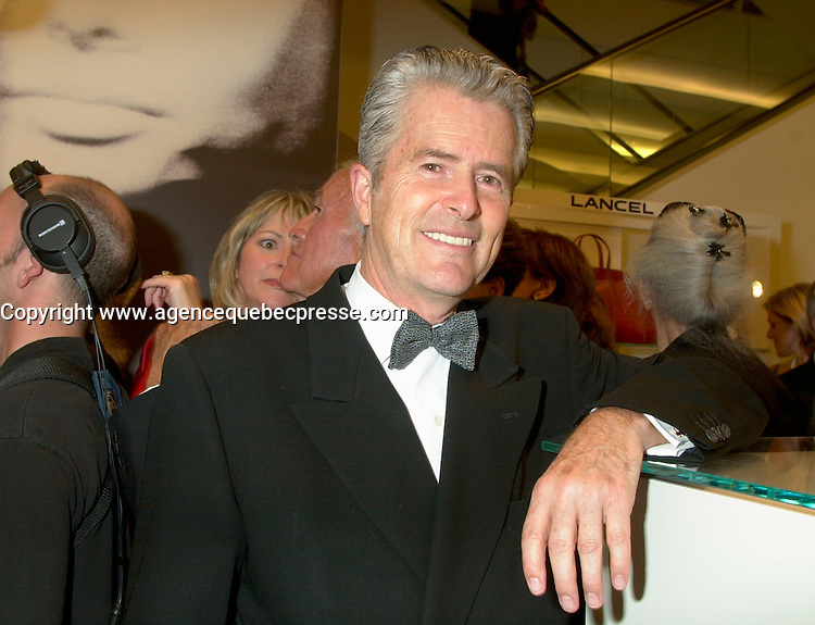 2002 File Photo, Montreal, Quebec, Canada<br /> <br /> Paul Roberge Delage, Founder and President <br /> Les Ailes de la Mode, pose for an exclusive photo,september 17, 2002 in downtown Montreal<br /> <br /> Mandatory Credit: Photo by Pierre Roussel- Images Distribution. (&copy;) Copyright 2002 by Pierre Roussel <br /> <br /> NOTE Nikon D-1 jpeg opened with Qimage icc profile, saved in Adobe 1998 RGB.