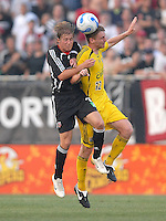 U.S. Open Cup Round of 16: Columbus Crew Eddie Gaven (12) goes up for a header against DC United Brian Carroll (16). DC United defeated the Columbus Crew in overtime 2-1, Tuesday, August 1, 2006, at Maryland Soccerplex.
