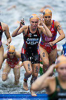 12 JUL 2014 - HAMBURG, GER -Tamara Gorman (USA) (centre) from the USA heads for transition at the end of the swim at the elite women's 2014 ITU World Triathlon Series round in the Altstadt Quarter, Hamburg, Germany  (PHOTO COPYRIGHT © 2014 NIGEL FARROW, ALL RIGHTS RESERVED)