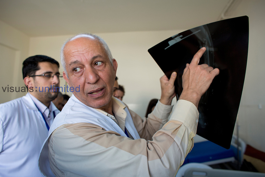MSF doctor with x-ray in a hospital for Syrian war victims, Ramtha, Jordan.