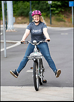 BNPS.co.uk (01202 558833)<br /> Pic: PhilYeomans/BNPS<br /> <br /> Freya Currie from Beryl bikes trys out the new scheme.<br /> <br /> An innovative bike share scheme has been wheeled out in a popular seaside resort as part of a bid to reduce congestion.<br /> <br /> The Beryl Bikes, which can be hired through a smartphone app, will be dotted around designated bays in Bournemouth and Poole, Dorset.<br /> <br /> It is the first time cycling firm Beryl have offered a citywide bike-hire service and will aim to reduce traffic in the bustling coastal region.