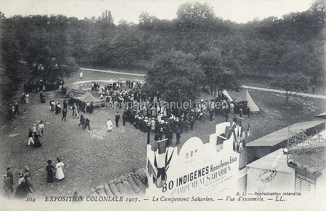 View of visitors at the Saharan Camp at the Colonial Exhibition of 1907, held in the Jardin d'Agronomie Tropicale, or Garden of Tropical Agronomy, in the Bois de Vincennes in the 12th arrondissement of Paris, postcard from the nearby Musee de Nogent sur Marne, France. The garden was first established in 1899 to conduct agronomical experiments on plants of French colonies. In 1907 it was the site of the Colonial Exhibition and many pavilions were built or relocated here. The garden has since become neglected and many structures overgrown, damaged or destroyed, with most of the tropical vegetation disappeared. The site is listed as a historic monument. Picture by Manuel Cohen / Musee de Nogent sur Marne