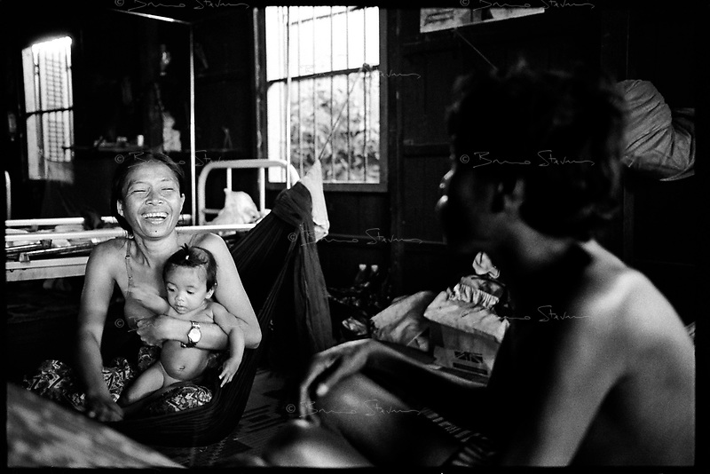 Siem Reap, Cambodia, December 2006..A rare smile. Dozens of TB patients live in very precarious conditions in 4 insalubrious barracks at the back of the Provincial Hospital compound. TB is endemic in the region, fueled by poverty, malnutrition, inadequate hygiene and the spreading of HIV/AIDS. The percentage of drug-resistant TB strains is on a sharp rise due to inadequate treatments.