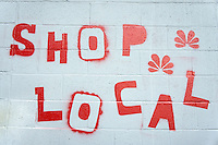 Shop Local sign painted on the wall of a building in Vancouver, BC, Canada