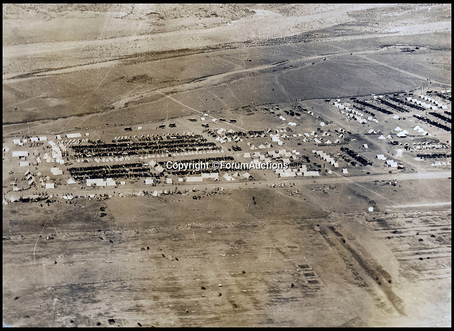 BNPS.co.uk (01202 558833)<br /> Pic: ForumAuctions/BNPS<br /> <br /> One of the camps at Risalpur.<br /> <br /> Stunning aerial photos taken by an RAF pilot who was based in northern India in the 1930s have come to light.<br /> <br /> The album of 52 photos of the North West Frontier, which today is part of modern day Pakistan, includes breathtaking snaps of the Khyber Pass and the Himalayas at 21,000ft.<br /> <br /> The pilot, who is pictured in the album and called himself 'Nuncs', also took an interest in the native population.<br /> <br /> There are snaps of a snake charmer entertaining the masses, while a father and son can be seen paddling in a traditional round basket boat on a river.