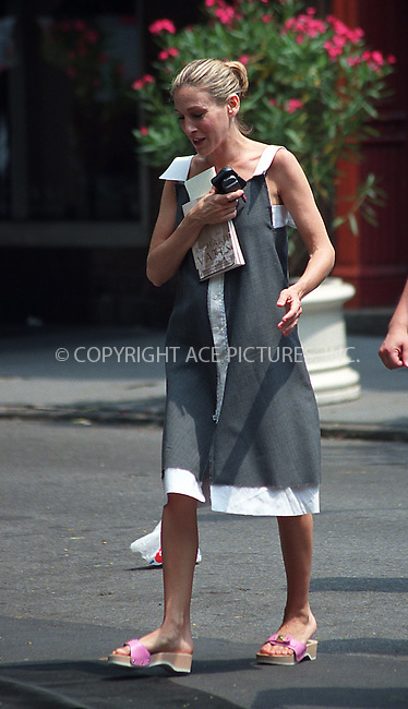 "Sarah Jessica Parker on the set of HBO's ""Sex and the City"" in West Village, New York. June 12, 2002. Please byline: Alecsey Boldeskul/NY Photo Press.   ..*PAY-PER-USE*      ....NY Photo Press:  ..phone (646) 267-6913;   ..e-mail: info@nyphotopress.com"