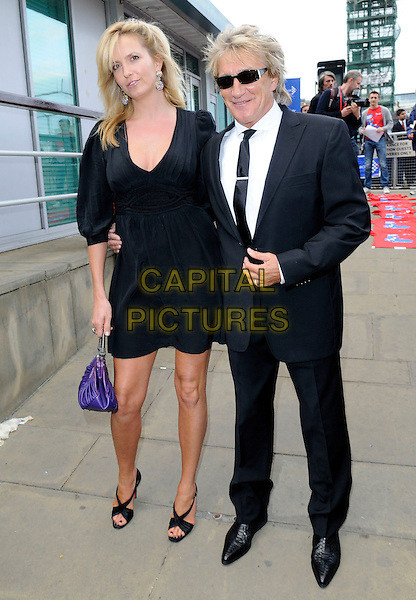 PENNY LANCASTER & ROD STEWART .The Busking Cancer Launch Gig, HMS Belfast, River Thames, London, England. .June 20th, 2009 .full length black dress shoes purple bag purse sunglasses shades suit tall short married husband wife.CAP/FIN.©Steve Finn/Capital Pictures.
