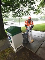NWA Democrat-Gazette/FLIP PUTTHOFF <br />RAINY DAY CHORES<br />John Brown with Arkansas Highway and Transportation Department works in the rain Wednesday May 3 2017 emptying  trash receptacles Wednesday May 3 2017 at the Arkansas Welcome Center on U.S. 71  in Bella Vista. Thirteen Arkansas Welcome Centers are located at points of entry into the state, including Siloam Springs. The centers offer a rest stop for travelers as well as maps and information about area attractions.