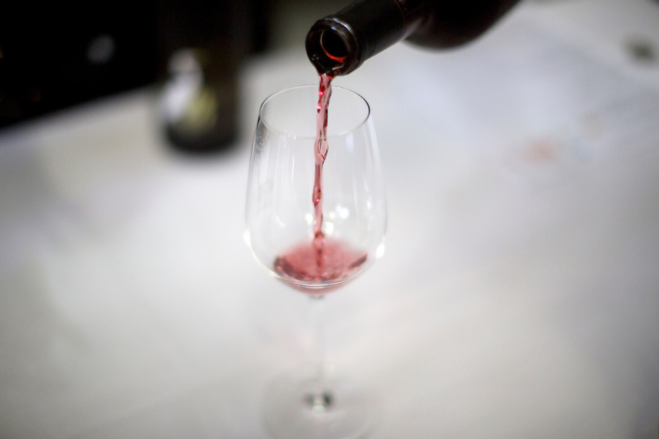 A glass of wine is poured during a tasting during Oliver Winery's Harvest Wine Festival on Saturday, Sept.. 25, 2014. (Photo by James Brosher)
