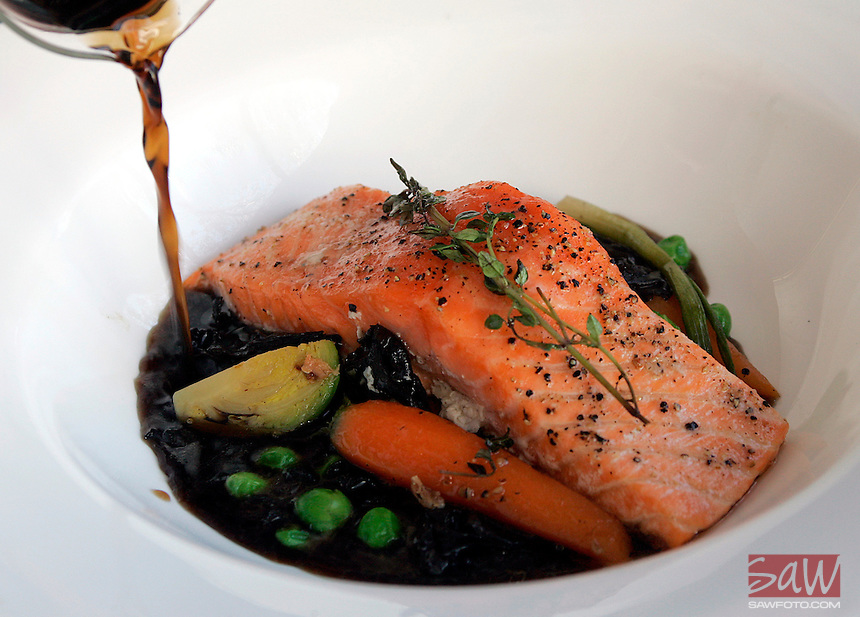 "Slow-roasted Irish salmon with snow peas, scallions and mushrooms. At the table server pours a fresh mushroom consome. Restaurant Review of "" eat. on sunset "" : This is revamp of the old Pinot Hollywood, which is open at both lunch and dinner."