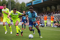 Anthony Stewart of Wycombe Wanderers battles Ben Dickenson of Colchester United during the Sky Bet League 2 match between Wycombe Wanderers and Colchester United at Adams Park, High Wycombe, England on 27 August 2016. Photo by Andy Rowland.