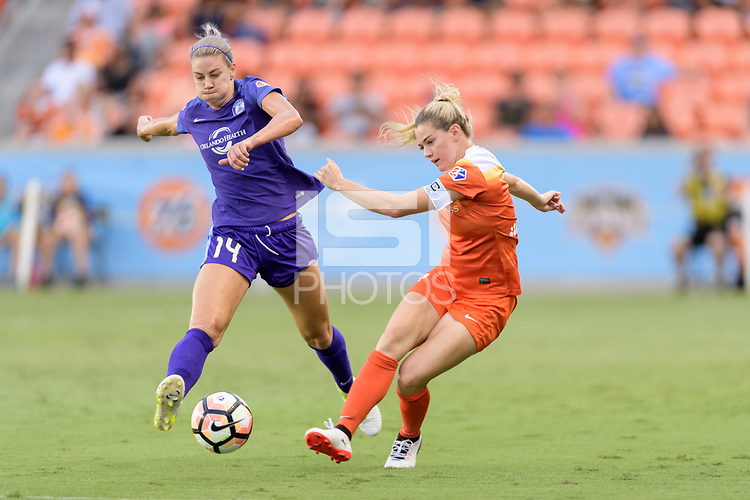 Houston, TX - Saturday June 17, 2017: Kealia Ohai passes the ball in front of Alanna Kennedy during a regular season National Women's Soccer League (NWSL) match between the Houston Dash and the Orlando Pride at BBVA Compass Stadium.