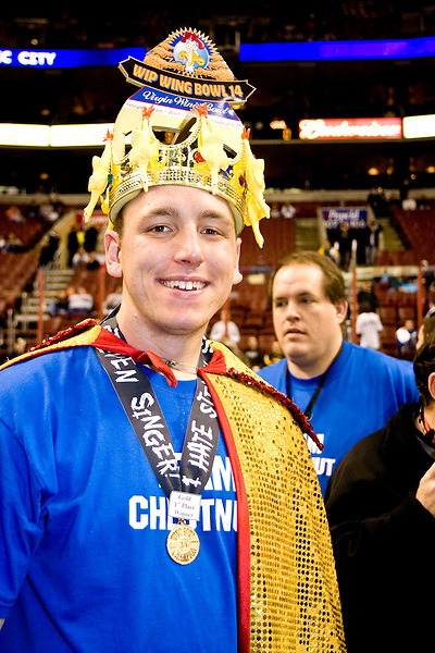 Professional eater Joey &quot;Jaws&quot; Chestnut emerges victorious at the 14th annual Wing Bowl, held in Philadelphia on February 3, 2006 at the Wachovia Center.<br /> <br /> The Wing Bowl is a competitive eating event in which eaters try and down the most hot wings in 30 total minutes in front of a crowd of 10,000 plus people.  The real show however is all around the eaters, from the various scantily clad women (known as &quot;Wingettes&quot;) that make up eaters' entourages, to the behavior of the fans themselves.