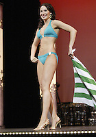 12 July, 2008:    Miss Emerald City Ada Rose Williams shows off her swim attire in the Physical Fitness in Swimsuit competition on stage during the 2008 Miss Washington pageant at the Pantages Theater in Tacoma , Washington.