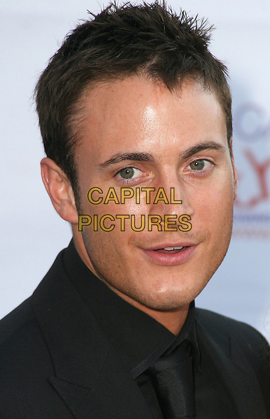 GARY LUCY.The Caudwell Children Butterfly Ball at Battersea Evolution, London, England. .May 20th, 2010 .headshot portrait black   .CAP/JIL.©Jill Mayhew/Capital Pictures