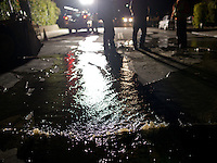 Water bubbles up from an underground water main which burst after a 6.1 magnitude earthquake hit the San Francisco Bay Area at 3:20 am, in Napa, California, USA, 24 August 2014. More than 70 people were sent to hospital with injuries and power outages darkened multiple cities in northern California after a 6.1-magnitude earthquake struck early on 24 August. The United States Geological Survey (USGS) said the earthquake struck at 3:20 am (1020 GMT) at a depth of 10.8 kilometres. It was located nine kilometres south-west of the Napa wine region, and 81 kilometres north of San Francisco.
