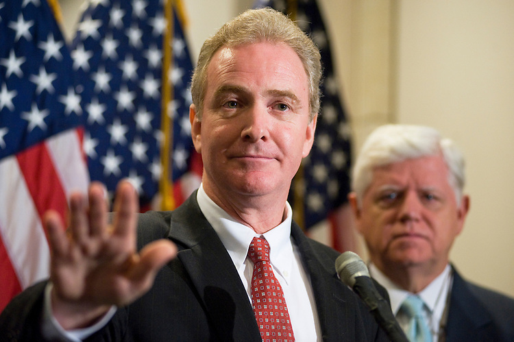 UNITED STATES - JULY 19:  Rep. Chris Van Hollen, D-Md., left, and, House Democratic Caucus Chairman John Larson, D-Conn., conduct a news conference on the debt ceiling debate after a meeting of the House Democratic caucus in the Capitol Visitor Center.  (Photo By Tom Williams/Roll Call)