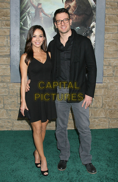 """guest & JC Chasez.""""Jack The Giant Slayer"""" Los Angeles Premiere held at Grauman's Chinese Theatre, Hollywood, California, USA..February 26th, 2013.full length dress jacket scarf black glasses  jeans denim.CAP/ADM/RE.©Russ Elliot/AdMedia/Capital Pictures."""