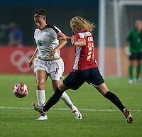 USWNT midfielder (11) Carli Lloyd steps past  Norwegian forward (11) Leni Larsen Kaurin during first round play for the 2008 Beijing Olympics in Qinhuangdao, China. .  The US lost to Norway, 2-0, at Qinhuangdao Stadium.
