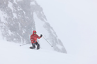 Back country skiing on the ruth glacier in a snowstorm, Alaska Range mountains, Interior, Alaska.