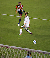 CD Chivas USA forward Laurent Merlin (10)scores the third and final goal of the match  past LA Galaxy defender Ty Harden (3) in second half stoppage time. CD Chivas USA defeated the LA Galaxy in the Super Clasico 3-0 at the Home Depot Center in Carson, CA, Thursday, September 13, 2007.