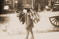 "Historical Photo:  ""Carrying Work Home, c. 1910"" .   Unknown photographer. Schoener, p. 175.  Photo '78."