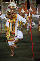 Bali, Indonesia.  Men Performing a Dance as Part of a Religious Ceremony Praying for a Bountiful Rice Harvest.  Dlod Blungbang Village, Pura Dalem Temple.