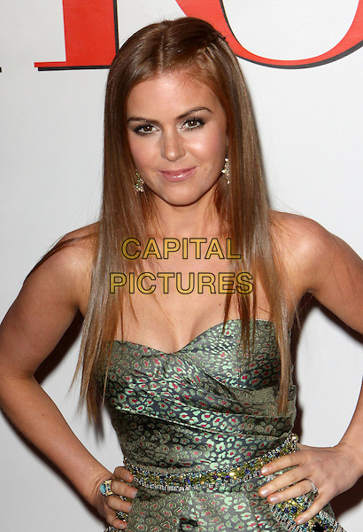 """ISLA FISHER.""""Confessions of a Shopaholic"""" World Premiere held at the Ziegfeld Theatre, New York, NY, USA..February 5th, 2009.half length strapless green print dress hands on hips bag silk satin.CAP/ADM/PZ.©Paul Zimmerman/AdMedia/Capital Pictures."""