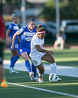 In a National Women's Soccer League Elite (NWSL) match, the Boston Breakers defeated the FC Kansas City, 1-0, at Dilboy Stadium on August 10, 2013.  FC Kansas City midfielder Desiree Scott (11) avoids a tackle by Boston Breakers midfielder Heather O'Reilly (9).