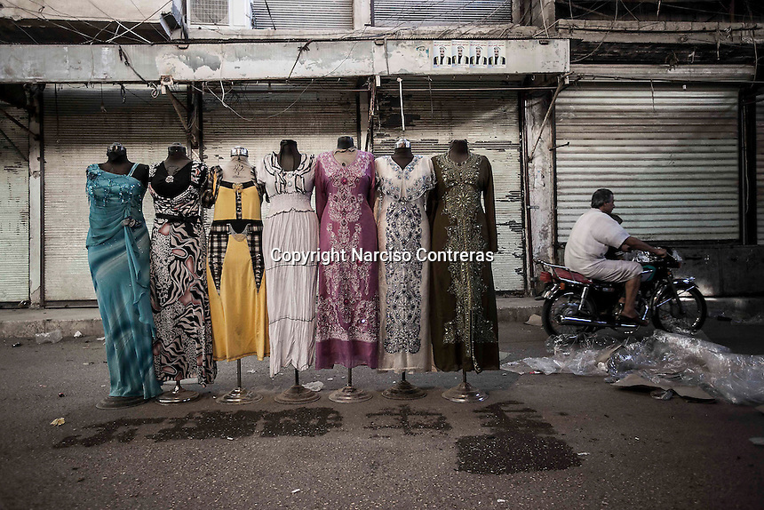 Dummies dressed with female clothes at the street market in downtown Manbij, city located at the northeast of Aleppo province.