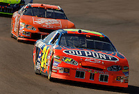 Nov 13, 2005; Phoenix, Ariz, USA;  Nascar Nextel Cup driver Jeff Gordon driver of the #24 Dupont Chevy leads Tony Stewart during the Checker Auto Parts 500 at Phoenix International Raceway. Mandatory Credit: Photo By Mark J. Rebilas