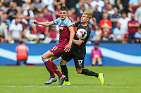 Declan Rice of West Ham United and Kevin De Bruyne of Manchester City during the Premier League match between West Ham United and Manchester City at the London Stadium, London, England on 10 August 2019. Photo by David Horn.