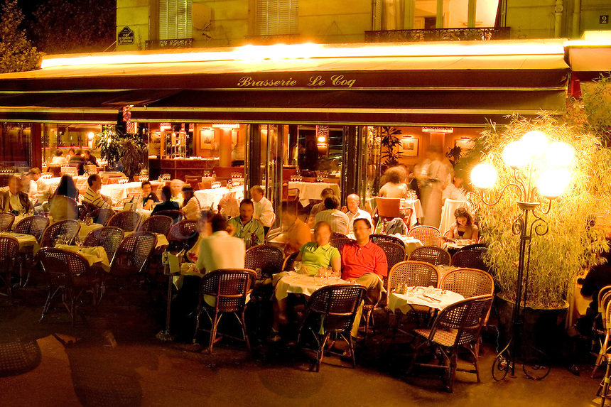 France Night Wonderful color of the street cafes in Paris France
