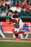 Lansing Lugnuts catcher Mike Reeves (25) makes a play on a blocked pitch during a game against the Peoria Chiefs on June 6, 2015 at Cooley Law School Stadium in Lansing, Michigan.  Lansing defeated Peoria 6-2.  (Mike Janes/Four Seam Images)