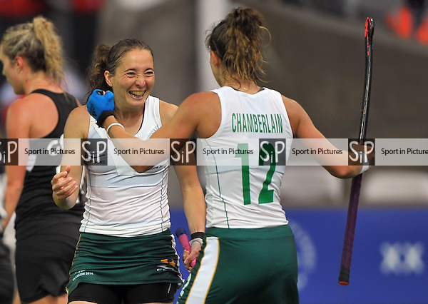 Goalscorer Kathleen Taylor (RSA) is congratulated by Dirkie Chamberlain (RSA, 12). South Africa (RSA) v New Zealand (NZL). Womens bronze medal match. Hockey. PHOTO: Mandatory by-line: Garry Bowden/SIPPA/Pinnacle - Tel: +44(0)1363 881025 - Mobile:0797 1270 681 - VAT Reg No: 183700120 - 020814 - Glasgow 2014 Commonwealth Games - Glasgow national hockey centre, Glasgow, Scotland, UK
