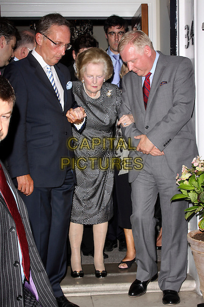 DON PORTER, BARONESS MARGARET THATCHER & MARK WORTHINGTON .At the Conservative Way Forward Summer Reception, London, England, UK..July 20th 2010.full length black white polka dot print dress shoes brooch blue suit arms linked profile grey gray looking down.CAP/AH.©Adam Houghton/Capital Pictures.