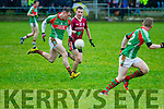 St Michaels/Foilmore's Mark Griffin brushes his was past the challenge of Dromids Shane O'Connor.