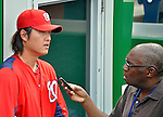 16 May 2012: Washington Nationals pitcher Chien-Ming Wang  is interviewed by MLB.com's Bill Ladson prior to game action against the Pittsburgh Pirates at Nationals Park in Washington, DC. The Nationals defeated the Pirates 7-4 in the first game of their 2-game series. Mandatory Credit: Ed Wolfstein Photo