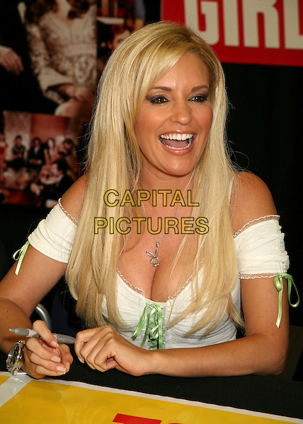 "BRIDGET MARQUARDT.""The Girls Next Door"" DVD and Magazine Signing at Tower Records, West Hollywood, California, USA..August 3rd, 2006.Photo: Byron Purvis/AdMedia/Capital Pictures.Ref: ADM/BP .half length white top cleavage playmate.www.capitalpictures.com.sales@capitalpictures.com.©Byron Purvis/AdMedia/Capital Pictures."