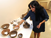 NWA Democrat-Gazette/ANDY SHUPE<br /> Carrie Wilson, a representative of the Quapaw tribe, speaks Wednesday, June 7, 2017, about a collection of funerary pottery from around the year 1200 at the University of Arkansas Archeological Survey in Fayetteville. The survey has repatriated items recovered from sites in Arkansas to the Quapaw and Caddo tribes.