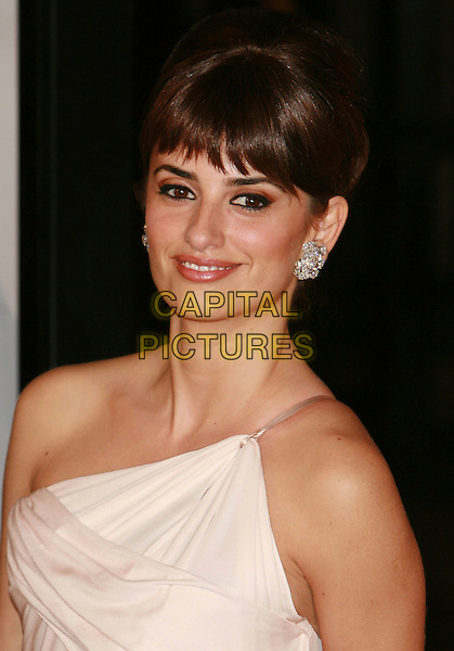 "PENELOPE CRUZ.AFI Fest 2006 presented by Audi hosts a presentation of ""Volver"" held at Arclight Cinerama Dome, Hollywood, California , USA, 2 November 2006. .portrait headshot fringe diamond earrings hair up smiling.Ref: ADM/CH.www.capitalpictures.com.sales@capitalpictures.com.©Charles Harris/AdMedia/Capital Pictures."